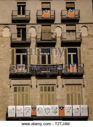 Building Façade with images of Catalan Government Officials imprisoned for voting for Independence from Spain March 2019 - Stock Photo
