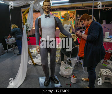 London, UK. 4th April, 2019. London, UK. 04th Apr, 2019. Following on from their 2018 feature success, Catrina In Bloom, the same team with the addition of Emma Jayne created two life-size figures of a bride and groom. The bride's face was sculpted by Emma Jayne, Coming from a background in fine art, Emma is famous for her amazing work and outstanding life-size showpieces and the groom's by Marc Suarez, Cake International Gold Award winner, First prize in 3D cake & choice of the public at Expogato and Novelty Cake finalist in the Cake Masters Awards 2016. Credit: Paul Quezada-Neiman/Alamy Live - Stock Photo