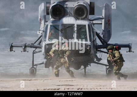 Russia. 04th Apr, 2019. KALININGRAD REGION, RUSSIA - APRIL 4, 2019: Servicemen of the Russian Baltic Fleet's amphibious assault forces take part in a military exercise in amphibious landing on an unimproved shore at the Khmelevka range. Over 20 surface vessels of the Russian Baltic Fleet, about 20 aircraft of the Russian Naval Aviation, and over 40 units of military hardware of Russia's Coastal Troops take part in the training. Vitaly Nevar/TASS Credit: ITAR-TASS News Agency/Alamy Live News - Stock Photo