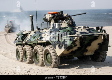 Russia. 04th Apr, 2019. KALININGRAD REGION, RUSSIA - APRIL 4, 2019: A BTR-82A armoured personnel carrier takes part in a military exercise in amphibious landing on an unimproved shore by the Russian Baltic Fleet's amphibious assault forces at the Khmelevka range. Over 20 surface vessels of the Russian Baltic Fleet, about 20 aircraft of the Russian Naval Aviation, and over 40 units of military hardware of Russia's Coastal Troops take part in the training. Vitaly Nevar/TASS Credit: ITAR-TASS News Agency/Alamy Live News - Stock Photo