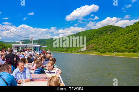 Kaub, Germany - MAY 2010: Great view from the passenger ship MS Ehrenfels with tourists, out to the Rhine River landscape on a sunny day with blue sky... - Stock Photo