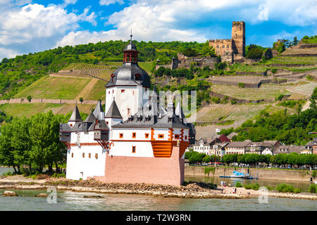Nice view of Pfalzgrafenstein Castle,  a toll castle on Falkenau island in the Rhine river & Gutenfels Castle in the background. Both castles are part... - Stock Photo