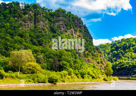 Fantastic landscape view of the steep Lorelei (Loreley in German) Rock on the riverbank of the River Rhine in the Rhine Gorge at Sankt Goarshausen in... - Stock Photo