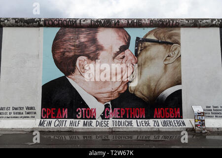 Famous 'My God, Help Me to Survive This Deadly Love' (or 'Fraternal Kiss') mural painting by Dmitri Vrubel at the East Side Gallery in Berlin. - Stock Photo