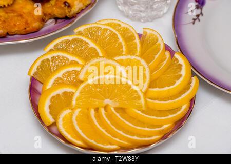 Lemon sliced on a plate. Selective focus - Stock Photo