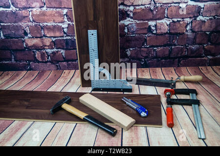 Tools for laying wooden Laminate or parquet on the floor - Stock Photo