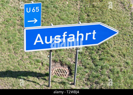 German road sign: motorway exit - Stock Photo