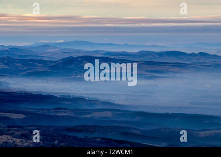 Winter mountain view from Kopitoto Hill, Vitosha Mountain, Sofia, Bulgaria on a December evening - Stock Photo