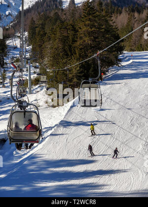 skilift and piste, skiing area Hochimst, Imst, Tyrol, Austria, Europe - Stock Photo