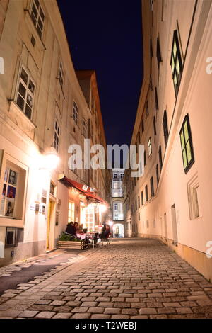 Blutgasse, narrow cobblestone street with historic baroque houses of old town Vienna at night. - Stock Photo