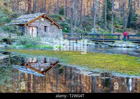 Italy, Aosta Valley, Rhemes Valley, Pellaud alpine lake, small hydroelectric plant (old watermill) - Stock Photo