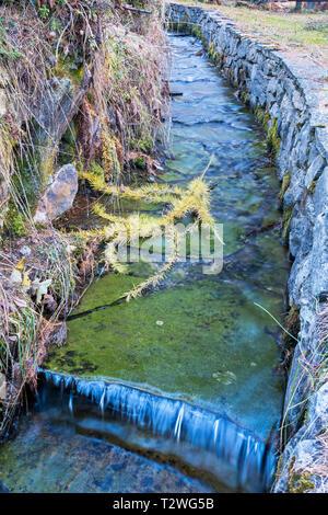 Italy, Aosta Valley, Rhemes Valley, Pellaud alpine lake, Grand Ru irrigation ditch - Stock Photo