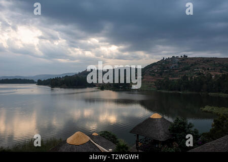 Sunset on Lake Bunyonyi from Birdnest Resort in South West Uganda, East Africa - Stock Photo