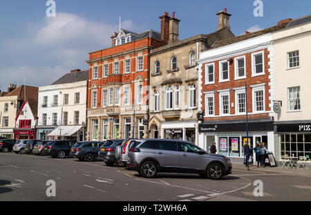 Devizes, Wiltshire, England, UK. March 2019. Shops and business premises on the Market Square - Stock Photo