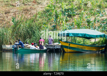 Local people on board boat waiting to be ferried across lake on Lake Bunyonyi in South West Uganda, East Africa - Stock Photo