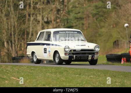 A 1965 Lotus Cortina taking part in a hillclimb event in the UK. - Stock Photo