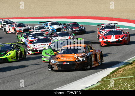 Italy - 29 March, 2019: The Start of the Race 12h Hankook at Mugello Circuit in Italy with Ferrari 488 GT3 of Bohemia Energy Racing Team on the lead - Stock Photo