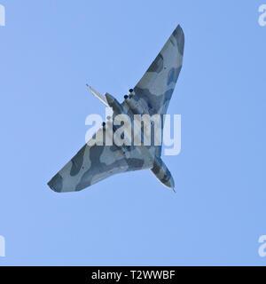 Avro Vulcan cold war era nuclear bomber in flight seen from below. - Stock Photo