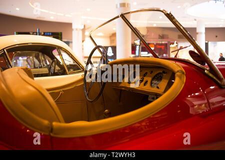 Poznan - Poland / March 28 2019, Cockpit of beautiful red Jaguar XK 150 convertible. - Stock Photo