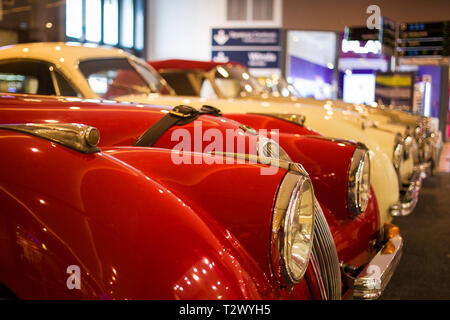 Poznan - Poland / March 28 2019, Front of beautiful classic red Jaguar XK 150 roadster - Stock Photo