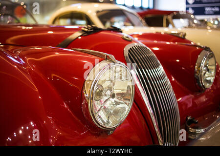 Poznan - Poland / March 28 2019, Imposing chrome grille of red Jaguar XK 150 - Stock Photo