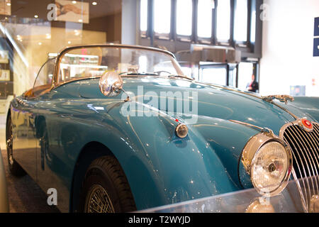 Poznan - Poland / March 28 2019 Baby blue Jaguar XK 150 exhibited indoors - Stock Photo