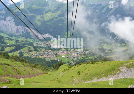 View from gondola down a Swiss mountain. - Stock Photo