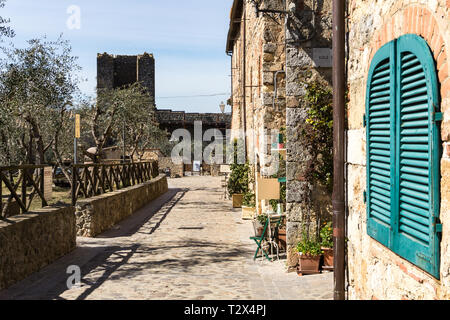 A typical street in the small walled town of Monteriggioni in the famous Tuscany region in North Italy - Stock Photo