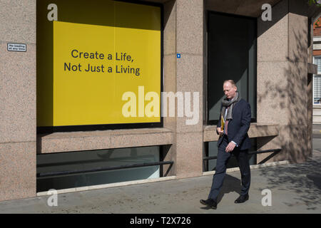 A create a life, not just for living slogan outside offices in the City of London, the capital's financial district, on 1st April, 2019, in London England. - Stock Photo