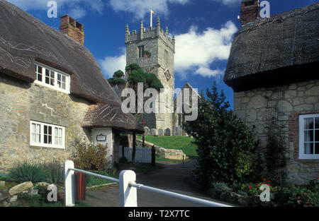 thatched cottages and and All Saints parish church in Godshill, Isle of Wight - Stock Photo