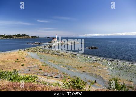Fisgard Lighthouse, Springtime Wildflowers and Sweeping Pacific Ocean Panorama across Juan De Fuca Strait near Victoria BC Canada on Vancouver Island - Stock Photo