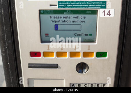 Detail of a modern pay-and-display parking meter in Oxford City Centre with display showing 'Please enter vehicle registration number' - Stock Photo
