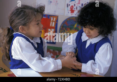 two primary school girls fighting - Stock Photo
