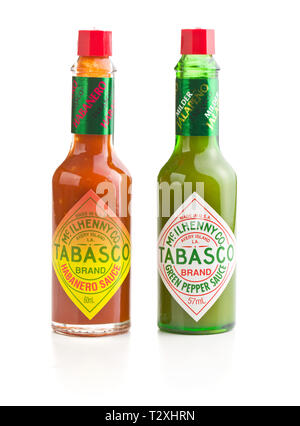 Tabasco hot sauce bottle. Red and green sauce. - Stock Photo