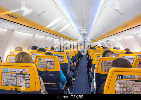 Passengers on an aircraft aeroplane  ready for take off on a Ryanair flight from Liverpool airport - Stock Photo