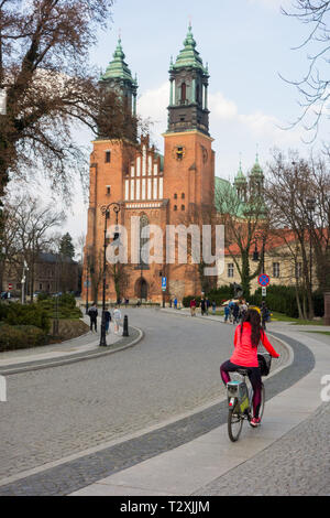 Tourists and visitors at Poznan basilica / cathedral standing on Ostrow Tumski Island,the oldest Cathedral in Poland dating from the 10th century - Stock Photo
