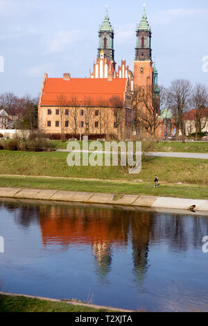 Poznan basilica / cathedral standing on Ostrow Tumski Island, seen over the river Warta, the oldest Cathedral in Poland dating from the 10th century - Stock Photo