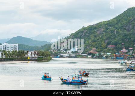 Nha Trang, Vietnam - May 5, 2018: Cai River with fishermen' blue boats. - Stock Photo