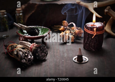 Fairy. Herbal incense and mysterious accessories on the table. - Stock Photo