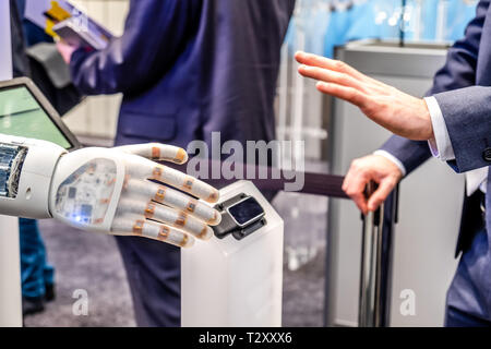 Human hand and robot's as a symbol of connection between people and artificial intelligence technology. - Stock Photo