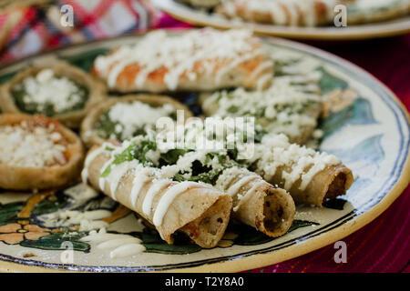 tacos dorados, flautas de pollo, chicken tacos and spicy Salsa Homemade Mexican food in mexico - Stock Photo