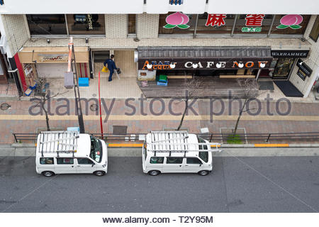 Takadanobaba, Japan, 03/23/2019 , View of the road in takadanobaba, with two van parked on side of street. - Stock Photo