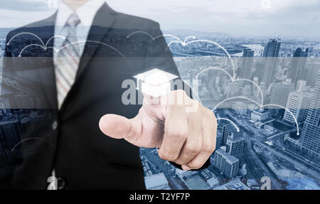 Business skills improvement and learning, online education and e-learning. Businessman touching on education screen - Stock Photo