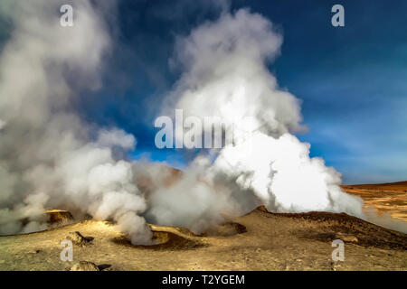 Hot steam pool geysers at the geothermal area of Sol de Manana, Bolivia - Stock Photo