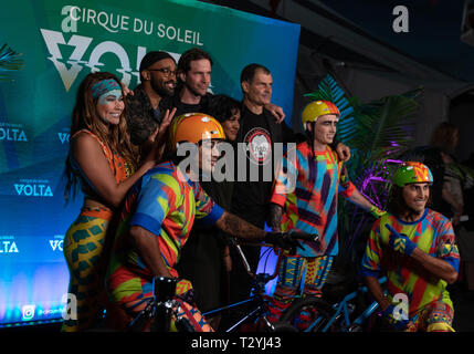 April 3, 2019 - BMX legend Mat Hoffman, third from right, smiles for a photo with Cirque du Soleil Volta cast members at the Del Mar Fairgrounds. (Credit Image: © Rishi Deka/ZUMA Wire) - Stock Photo
