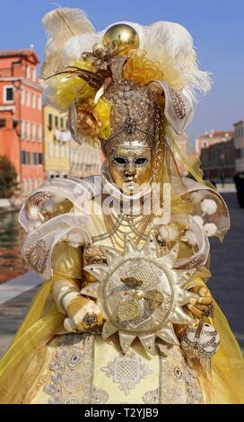 Woman with traditional Venetian mask, Carnival in Venice, Veneto, Italy - Stock Photo