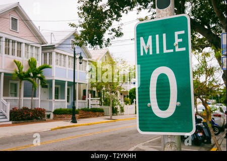 Mile Marker 0 sign marking the start of US Route 1, the highway that runs on the East Coast from Florida to the Canadian border in Maine in Key West - Stock Photo