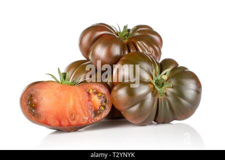 Group of three whole one half of dark fresh tomato primora isolated on white background - Stock Photo
