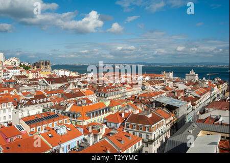 11.06.2018, Lisbon, Portugal, Europe - An elevated view of the historic city district Baixa with the Tagus River in the backdrop. - Stock Photo