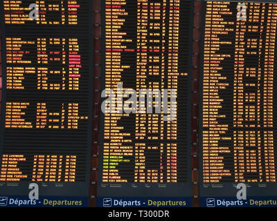 close up of a flight departure board charles degaulle airport, paris - Stock Photo